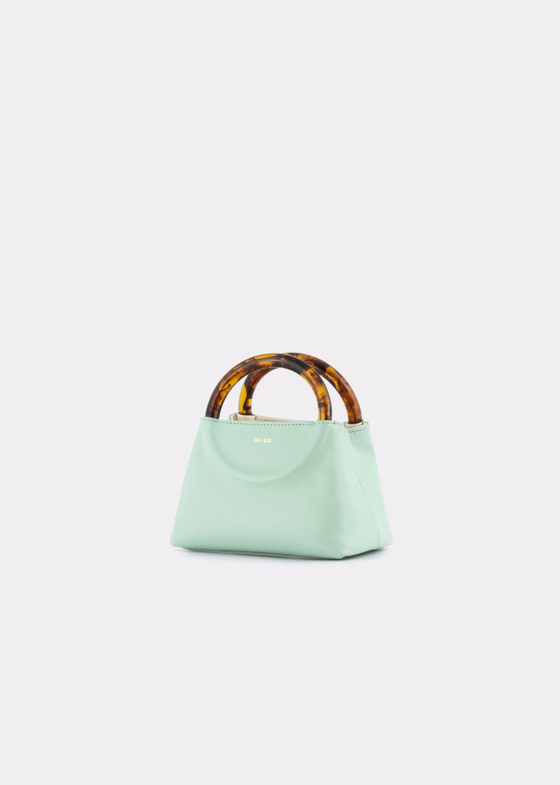 NIDO Bolla Micro bag Pastel Sky leather Amber_side view