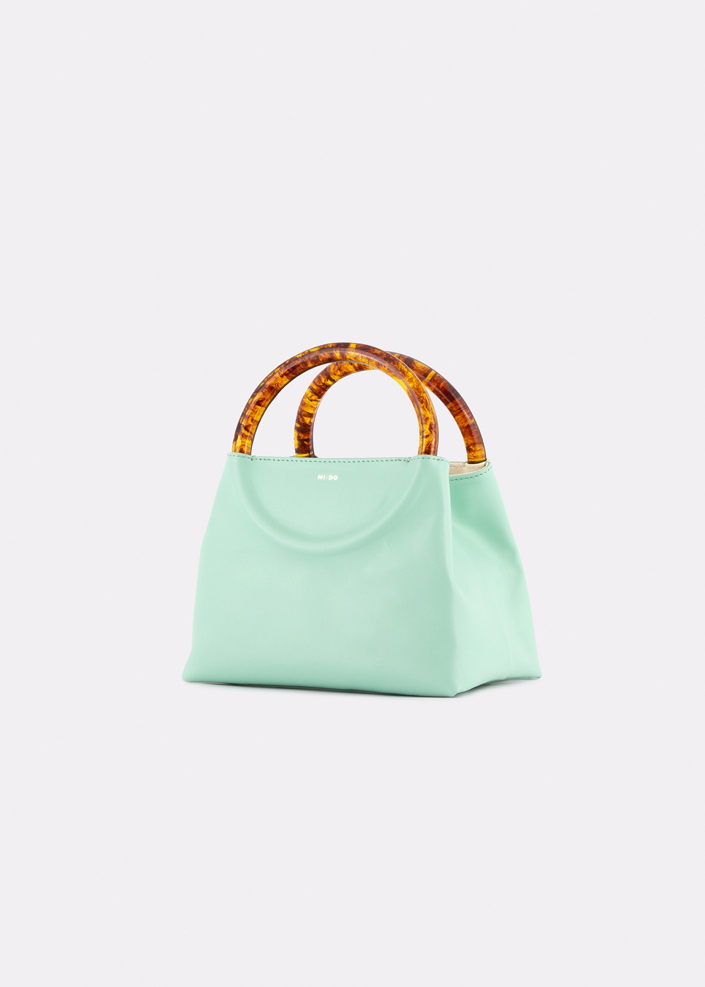 NIDO Bolla Mini bag pastel sky/Amber side